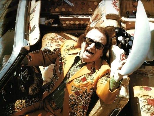Nudie Cohn in his Cadillac El Dorado, which will be