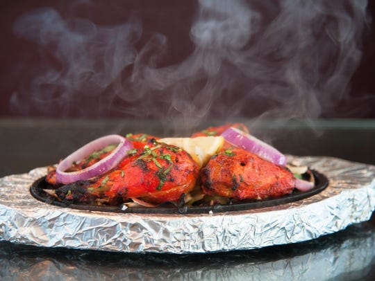 Tandoori chicken is a popular order at Monsoon in Cherry Hill.