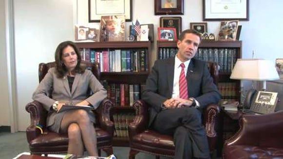 Attorney General Beau Biden with State Prosecutor Kathy Jennings last year.