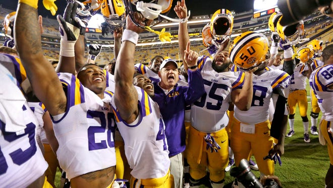 LSU Tigers head coach Les Miles and the Tigers celebrate their 41-3 victory against the Kentucky Wildcats at Tiger Stadium.