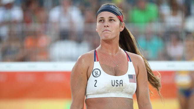 Aug 9, 2016; Rio de Janeiro, Brazil; Brooke Sweat (USA) looks on during the women's preliminary against Brazil in the Rio 2016 Summer Olympic Games at Beach Volleyball Arena.