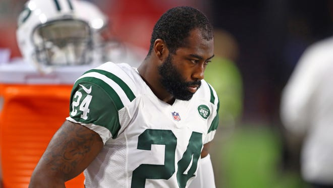 Many Jets season ticketholders who ponder the decline in value of their Personal Seat Licenses feel as somber as cornerback Darrelle Revis looks here.