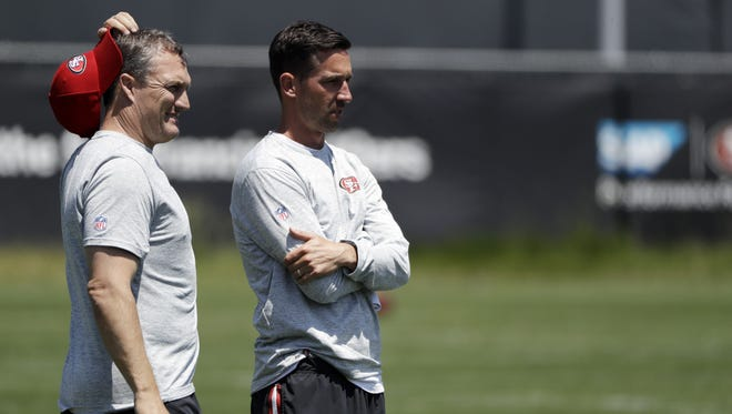 San Francisco 49ers head coach Kyle Shanahan, right, and general manager John Lynch watch the team's organized team activity at its NFL football training facility Tuesday, May 23, 2017, in Santa Clara, Calif.