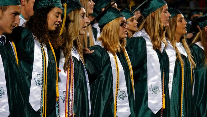 Students attend the Santa Fe High School graduation ceremony June 1, 2018, in Santa Fe, Texas. More than 300 seniors at the Southeast Texas high school have received their diplomas with memories of a deadly mass shooting fresh in their minds.