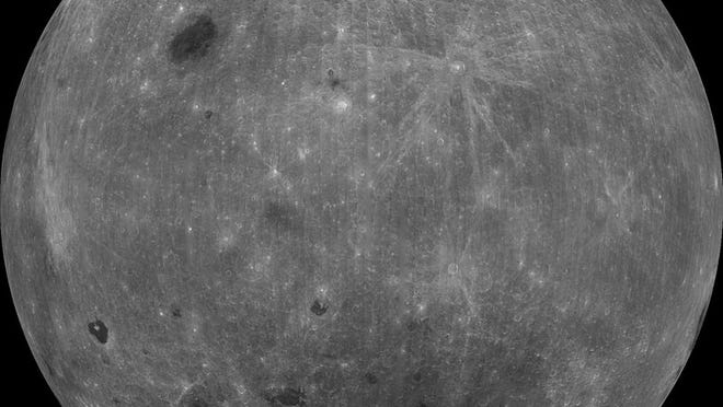 The far side of the moon, or the back of the Man in the Moon's head. This is a collage of about 50,000 images taken in 1998 by NASA's Clementine orbiter.