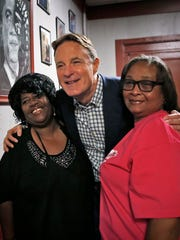 Democrat Evan Bayh poses with Tammie Williams (left) and Nora Stockton during the campaign for his former Senate seat.