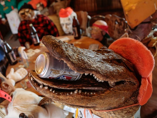 "A stuffed alligator enjoys a beer inside Camp Go For Beer, a full-size cabin that was built for the band Da Yoopers to film the video to their song ""Second Week of Deer Camp."""