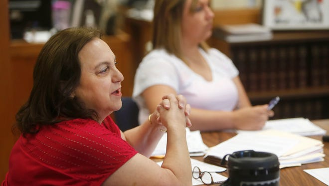 Cristian County Auditor Lacey Hart discusses the budget with the county commissioners during a meeting on Thursday, June 23, 2016.