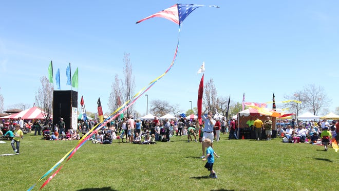 Flyers take to the air at the Family Kite Festival at Veterans Park on Milwaukee's lakefront on May 24, 2014.