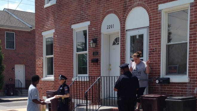 Wilmington police distribute leaflets seeking information after a homicide.