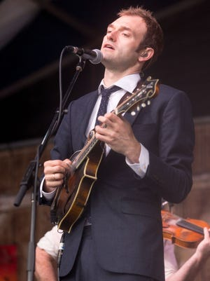 Musician Chris Thile of Punch Brothers performs live during the New Orleans Jazz & Heritage Festival at Fair Grounds Race Course on May 1, 2016 in New Orleans, LA.