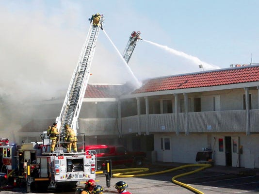 El Paso firefighters work to put out fire at a Motel 6 at 1330 Lomaland Drive Sunday afternoon.