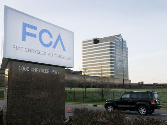 In this Tuesday file photo, the Fiat Chrysler Automobiles sign is seen after being unveiled at Chrysler World Headquarters in Auburn Hills, Mich. The U.S. government will fine Fiat Chrysler a record 105 million for violating safety laws in a series of recalls, a person briefed on the matter says. The National Highway Traffic Safety Administration will reveal the fine on Monday says the person who didn't want to be identified because the official announcement hasn't been made.