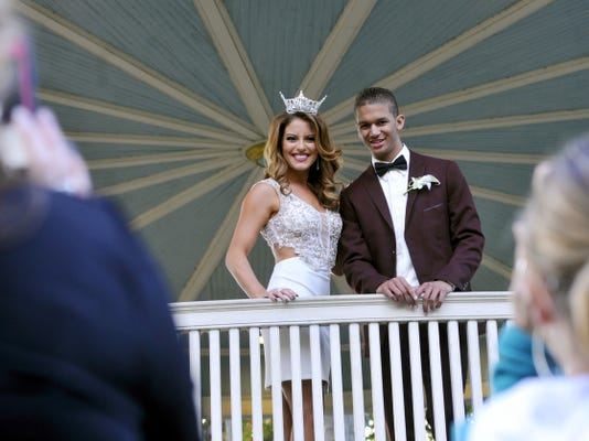 Marcus Josey, right, and Miss New Jersey Lindsey Giannini have their photo taken at the gazebo in Farquhar Park on Saturday. Josey, who is battling leukemia, asked Giannini to his homecoming at Northeastern and she accepted. The pair plan on more trips and a lifelong friendship.