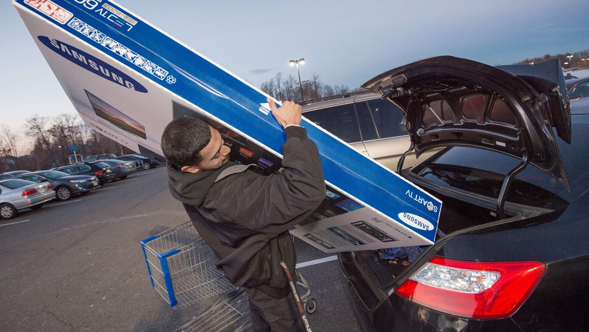 """PAUL J. RICHARDS, AFP/Getty Images  Umer Gonzalez loads his TV at a Walmart in Fairfax, Va., on Black Friday last year. Black Friday shopper Umer Gonzalez loads his Samsung big screen TV after purchasing it at a Walmart in Fairfax, Virginia, on November 28, 2014. Black Friday, the biggest US shopping """"holiday,"""" kicked off with expectations that lower gasoline prices and higher consumer confidence could mean better year-end retail sales than last year. But there was little sign of the buying fever of years past, after many retailers started Black Friday sales early, turning Thursday's Thanksgiving Day holiday into what the industry has dubbed """"Gray Thursday.""""      AFP Photo/Paul J. RichardsPAUL J. RICHARDS/AFP/Getty Images ORG XMIT: 525813891 ORIG FILE ID: 535751273"""
