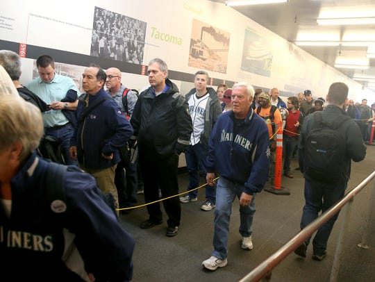 Bremerton ferry passengers wait in line at Colman Dock