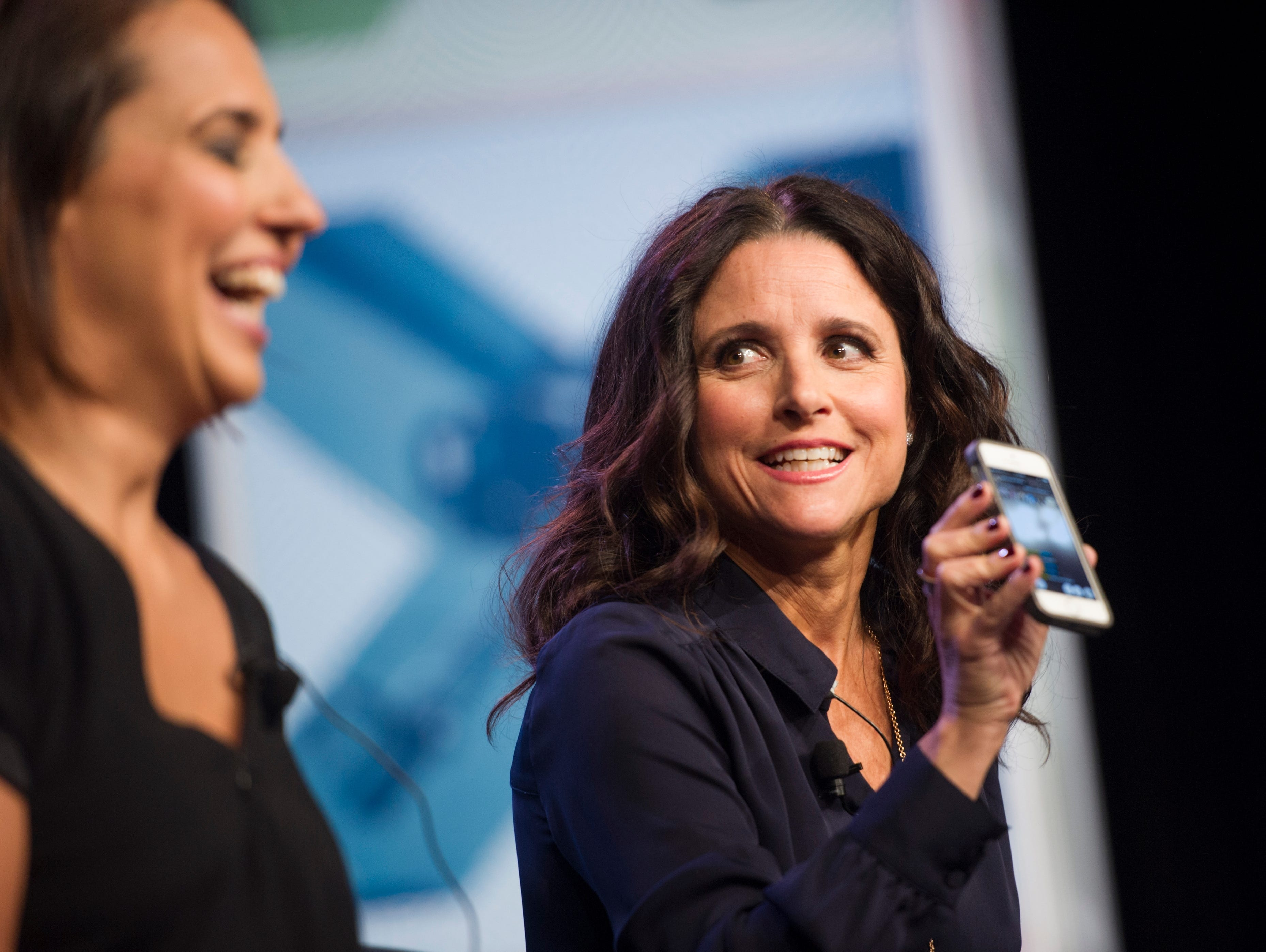 Actress Julia Louis-Dreyfus on stage with Anne Fulenwider, Editor in Chief, Marie Claire, while live feeding via the Meerkat app arriving for the SXSW panel