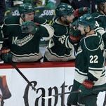 Minnesota Wild forward Nino Niederreiter (22) celebrates his goal with teammates during the second period against the Chicago Blackhawks in Game Four of the second round of the 2014 Stanley Cup Playoffs on Friday at Xcel Energy Center.