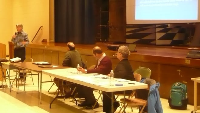 EPA remedial project manager Joe Gowers reviewing information on the Ringwood Superfund site during a public meeting on a   recent groundwater report.