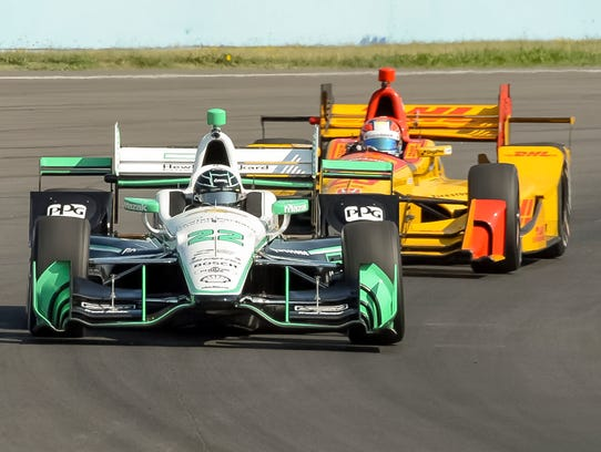 Simon Pagenaud is followed closely by Indy Lights driver