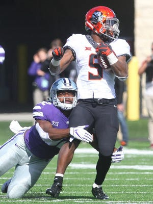 Kansas State linebacker Justin Hughes (32) brings down Oklahoma State running back Justice Hill (5) during a 2018 game at Bill Snyder Family Stadium. Hughes is back for his senior season after missing last year with a knee injury.