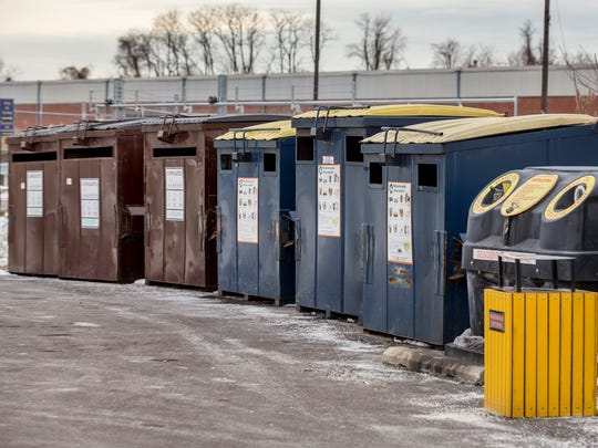 Recycling collection bins sit in a public drop off area at the Delaware Solid Waste Authority in New Castle on Tuesday afternoon.