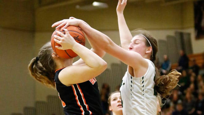 Howell's Leah Weslock blocks the shot of Brighton's Jesslyn Thumm in the Highlanders' 38-36 victory over the Bulldogs on Monday Feb. 19, 2018.