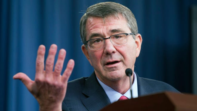 In this Jan. 28, 2016 photo, Defense Secretary Ash Carter gestures during a news conference at the Pentagon. The Pentagon is looking for a few good computer hackers. Screened high-tech specialists will be brought in to try to breach the Defense Department's public Internet pages in a pilot program aimed at finding and fixing cybersecurity vulnerabilities.