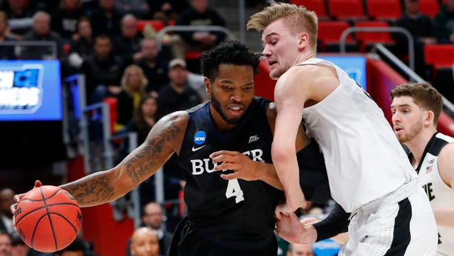 Butler forward Tyler Wideman (4) drives on Purdue forward Matt Haarms (32) during the first half of an NCAA men's college basketball tournament second-round game in Detroit, Sunday, March 18, 2018.