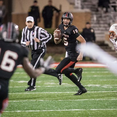 Ball State's Riley Neal scrambles to pass as Bowling