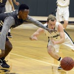 Elic Cadet of Ocoee and Holy Trinity's Logan Folsom scramble for a loose ball during Wednesday's regional quarterfinal game.