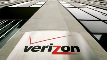File photo taken in 2006 shows a sign on the side of one of the Verizon buildings in New York.