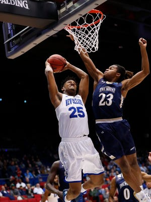 New Orleans Privateers forward Travin Thibodeaux (25) goes to the basket is defend by Mount St. Mary's Mountaineers guard Greg Alexander (23) in the first half in the first four of the 2017 NCAA Tournament at Dayton Arena.