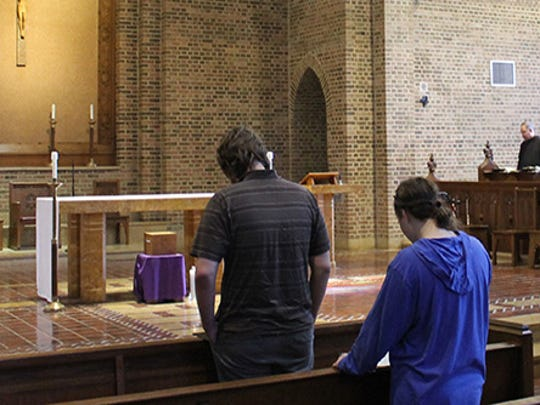 Benedictine monks welcome students and faculty members from St. Gregory's University near Shawnee, Okla., to attend the frequent prayers at the abbey church on campus. The monks plan to keep serving Oklahoma's Catholic community even as the university closes in December.