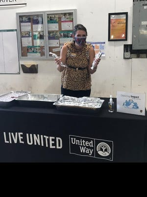 United Way of Grayson County Director of Development Katie Eubank works a table at a kickoff for the 2020 United Way campaign [courtesy photo].