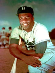 FILE - In this 1952 file photo, Brooklyn Dodgers baseball player Jackie Robinson poses. Forced from the field by the new coronavirus, Major League Baseball is moving its annual celebration of Jackie Robinson online. The Jackie Robinson Foundation is launching a virtual learning hub to coincide with the 73rd anniversary Wednesday, April 15, 2020, of Robinson breaking the major league color barrier. (AP Photo/File)