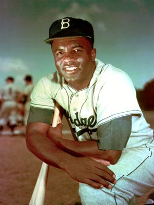 Jackie Robinson, seen in this 1952 photo, is celebrated every year on April 15, the day he broke down baseball's color barrier in 1947.