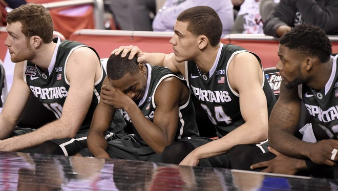 MSU's Tum Tum Nairn Jr. and Gavin Schilling react after losing to Duke 81-61 in the Final Four on April 3, 2015, at the end of Nairn's freshman season and Schilling's sophomore year.