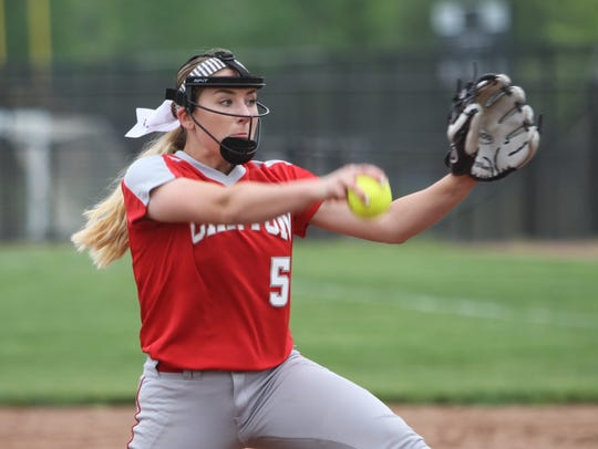 Canton's Shae Scott pitches in a 9-3 loss to Hartland