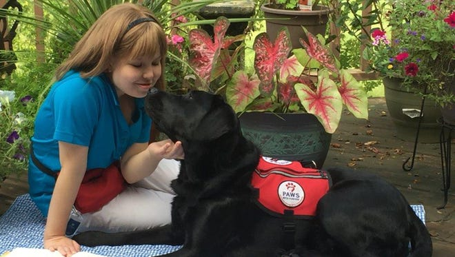 """Sarah and her service dog Gabby, who she says """"helps me with balance issues, each and every day"""""""
