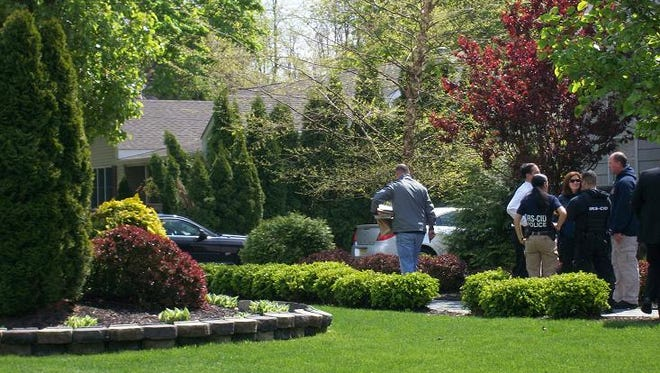FBI and IRS agents execute a search warrant at the Toms River home of Donna Mansfield on April 22, 2010.