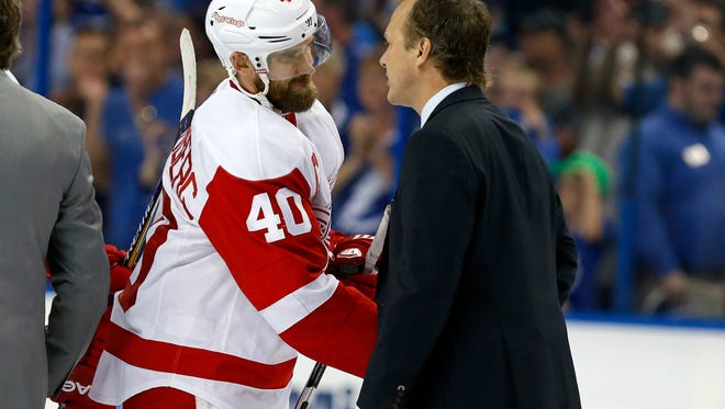Red Wings captain Henrik Zetterberg shakes hands with Lightning coach Jon Cooper after the Wings' 2-0 loss to the Lightning in Game 7 Wednesday in Tampa.