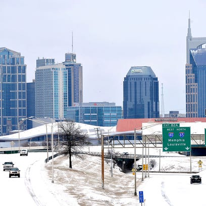 Traffic moves slowly on Interstate 65 covered with