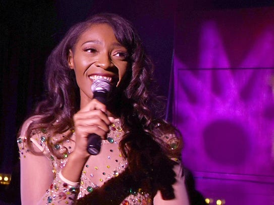 Kira McGlothen, singer and host for Essence performs