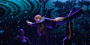 "Alex Sharp floats above cast members in the Broadway play ""The Curious Incident of the Dog in the Night-Time."""