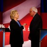 Hillary Clinton and Bernie Sanders speak during a break at the Democratic debate on Jan. 17, 2016, in Charleston, S.C.