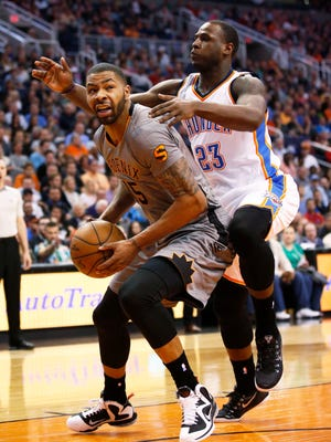 Phoenix Suns Marcus Morris is guarded by Oklahoma City Thunder Dion Waiters during NBA action on Feb. 26, 2015, in Phoenix.