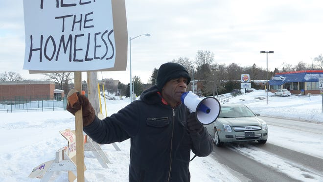 Activist Bobby Holley stands at the intersection of North Avenue and Roosevelt Monday afternoon appealing for help for homeless people.