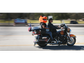 Motorcyclists participating in a toy run head north
