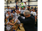 Coach Tony Harper applauds Cathedral players and students